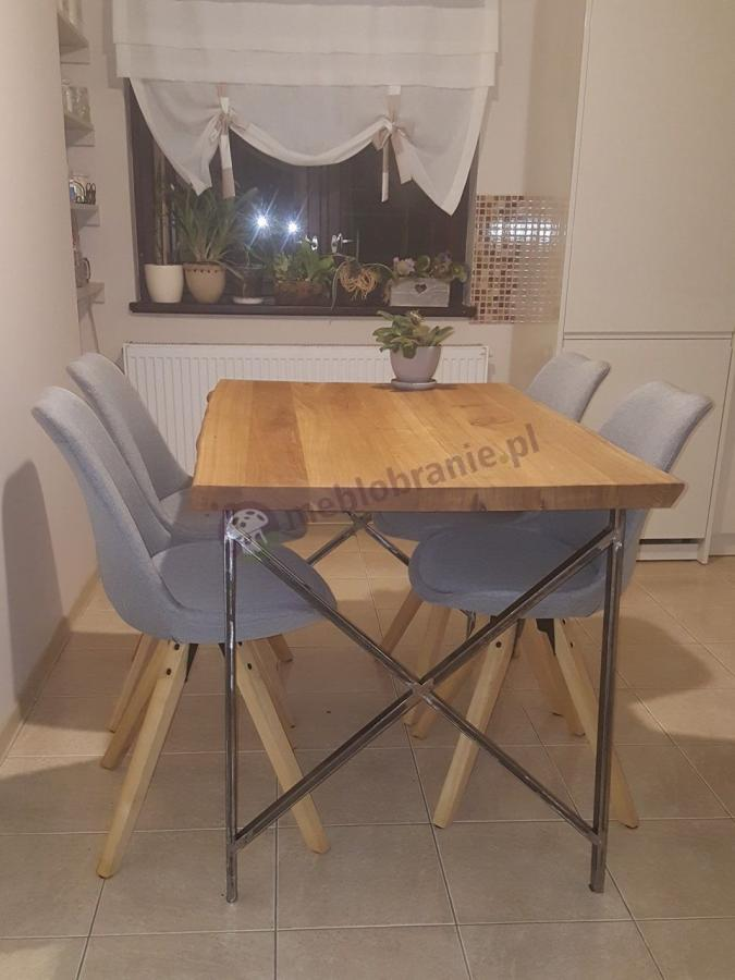 Designerskie krzesła skandynawskie jasnoszare Actona Dima