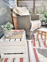 Fotel ogrodowy Rattan Style Iowa w ciekawej aranżacji
