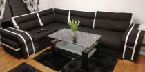 Sofa rozkładana do spania codziennego czarna z białymi detalami