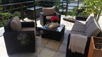 Technorattanowy komplet z dwoma fotelami z podłokietnikami i sofą trzyosobową