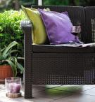 Sofa ogrodowa Corfu Love Seat Max - brązowa/czekoladowa w ogrodzie