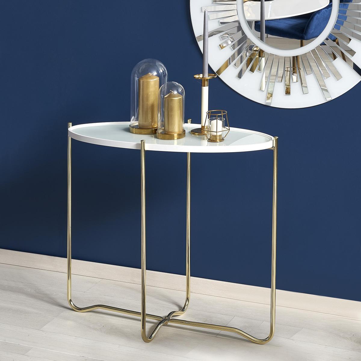 Nowoczesna konsola ze szklanym blatem i złotymi nogami - aranżacja